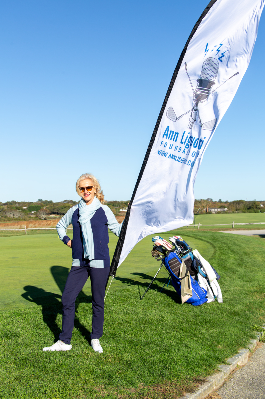 Ann Liguori gets ready to welcome golfers to the tournament