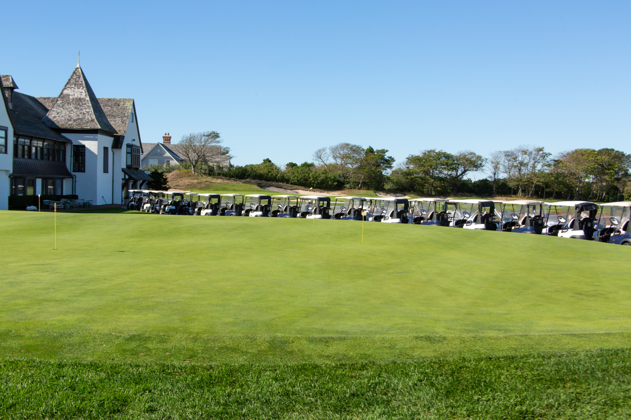 The carts are waiting for the golfers