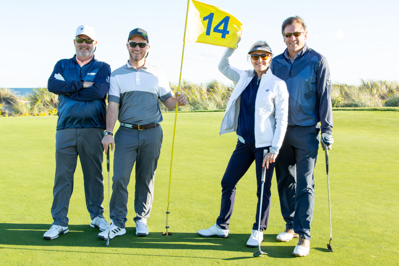 Ann and her foursome on the iconic 14th hole along the ocean