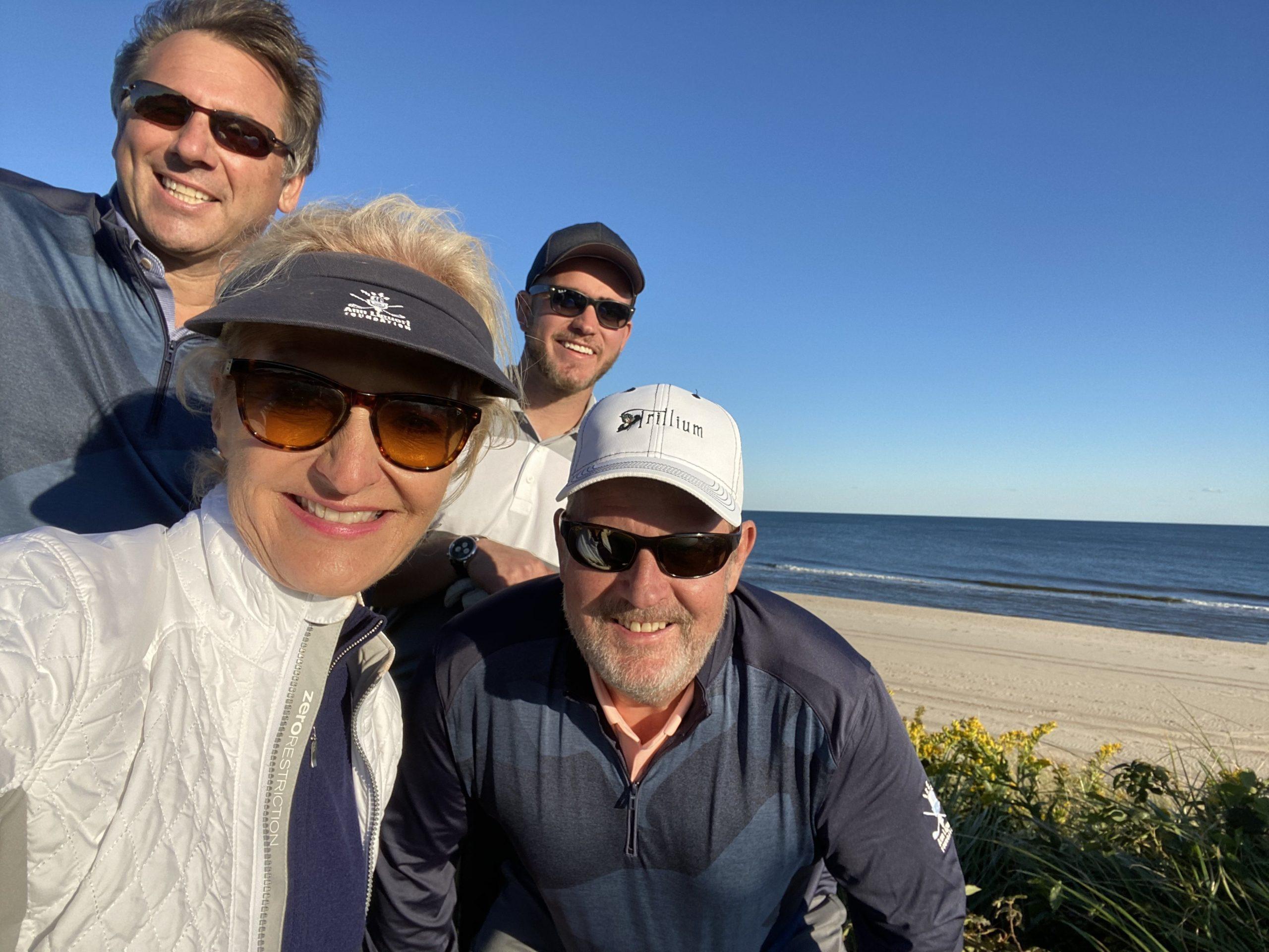 Ann, Scott Vallary, Steve Skidgel & Christian Skidgel selfie along the ocean at the Maidstone Club